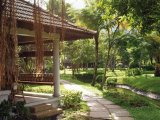 Lush tropical gardens at the Kumarakom Lake Resort, Kerala