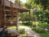 Lush tropical gardens at the Kumarakom Lake Resort, Kerala