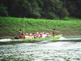 Sailing by a motorized Canoe, to visit the Enmbera Indians